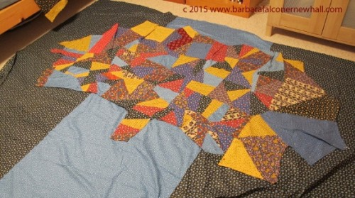 Multicolored calico piecing for a quilt top in the shape of a tree. Photo by Barbara Newhall
