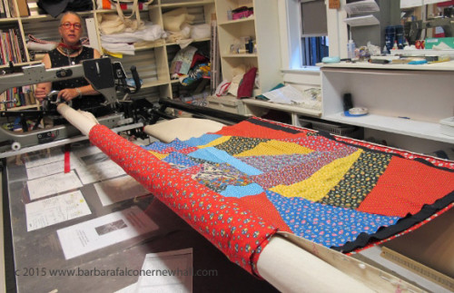 Sue Mary Fox mounted a calico crazy quilt --quilt top, batting and backing -- on her longarm sewing machine in her Berkeley studio. Photo by Barbara Falconer