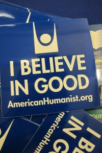 "A blue flyer reads ""I believe in good., American Humanist.org. Photo by Barbara Newhall"