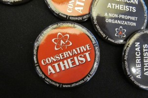"A red button with the words ""Conkservative Atheist"" was handed out by American Atheists at a 2014 meeting of the Religion Newswriters Conference. Photo by Barbara Newhall"
