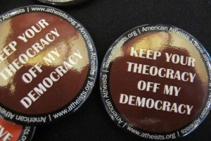 "A button handed out at the 2014 Religion Newswriters Conference reads ""Keep your theocracy off my democracy."" Photo by Barbara Newhall"