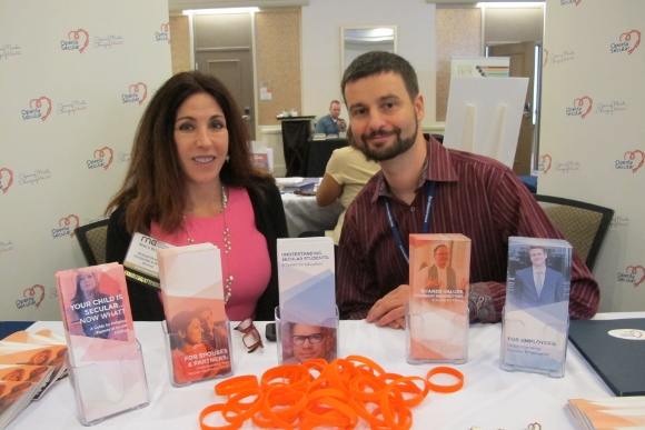 At an exhibit table at the 2014 meeting of the Religion Newswriters Association are Robyn Blumner,Executive Director of the Richard Dawkins Foundation, and Todd Stiefel of  Stiefel Freethought Foundation. Photo by Barbara Newhall