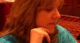 cindy weyant newhall at the 2010 national open chess tournament in Las Vegas pondering a move. Photo by Barbara Newhall