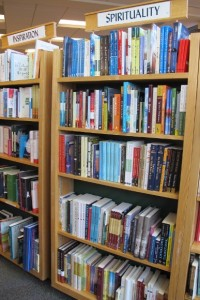 """Barbara Falconer Newhall's book, """"Wrestling with God,"""" is shelved for her book launch in the spirituality section of the Book Passage book store in Marin county, California. Photo by Barbara Newhall"""