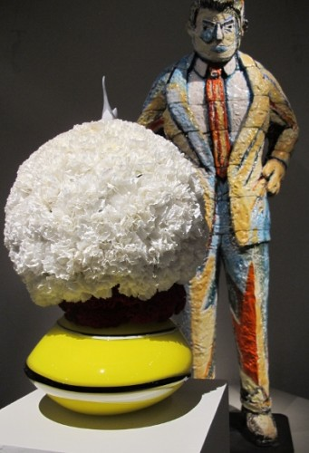 "Round floral arrangement of white carnations by Ricardo Aguilar of VelaFlor,  San Francisco. ceramic sculpture by  Viola Frey, ""Man Ob"