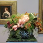 "Floral design at the FAMSA Bouquets to Art exhibition 2015 by Andrea Frenkel of Ukiah, CA. Lily and Mint. the design complements George DF Brush's 1890 painting ""A Celtic Huntress."" Photo by Barbara Newhall"
