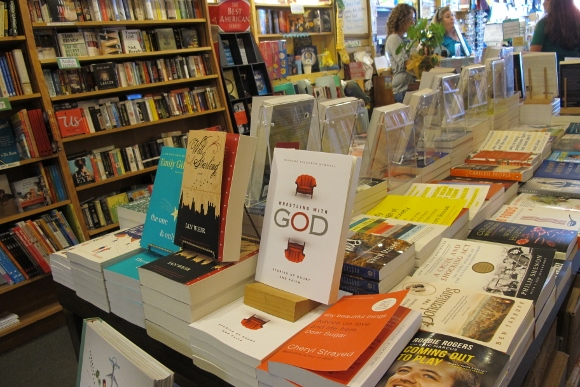 "book events Barbara Falconer Newhall's book ""Wrestling with God"" is on display on a counter in A Great Good Place for Books bookstore in Oakland California. Photo by Barbara Newha"
