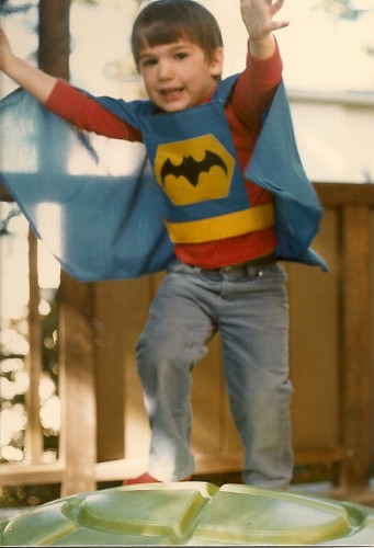 Babysitter challenge. Four-year-old boy dressed as Batman jumps. PHoto by Barbara Newhall