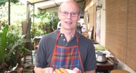 Jon Newhall takes a class in Thai cooking in Bangkok and shows off his dish. Photo by Jon Newhall