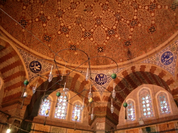 Ceiling and arched windows of a mosque in Instanbul, with hanging lights. Does Islam scare you? Photo by Barbara Newhall