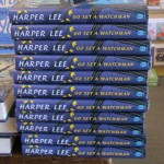 "a stack of copies of ""Go Set a Watchman"" by Harper Lee in a bookstore. photo by barbara newhall"