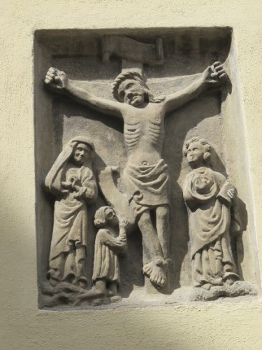 This stone imae of the crucifixion, of Jesus on the cross is on the outside of the University of Bamberg auditorium. Aula. Photo by Barbara Newhall