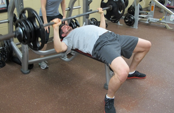 Weight lifting. My son Peter Newhall, a young man in his 30s, bench presses at a gym. Photo by Barbara Newhall