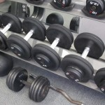 Weight lifing. Dumbbells of various sizes on a rack in a gym. Photo by Barbara Newhall