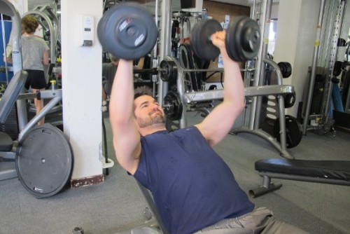 weight lifting. My son Peter Newhall, a man in his 30s, lifts dumbbells at the gym. Photo by Barbara Newhall