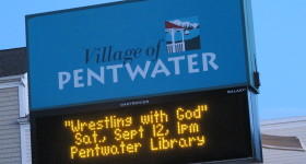 The Pentwater Michigan marquee announces book talk by Barbara Falconer Newhall on her book, Wrestling with God. Photo by Barbara Newhall
