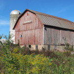 "An unused barn and silo in Mason county, MIchigan. Photo by Barbara Newhal. Barbara Falconer Newhall travels up and down Michigan's lower peninsula, visiting friends and family and putting on book events for ""Wrestling with God."""