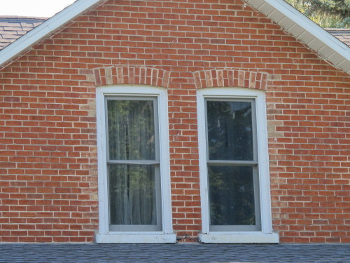Red brick work around upper story windows on a farm house in Mason county, Michigan. Photo by Barbara Newhall