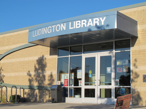 "The sleek, modern rear entrance to the Ludington, MIchigan, library contrasts with its formal facade facing the main street. Photo by Barbara Newhall. Barbara Falconer Newhall travels up and down Michigan's lower peninsula, visiting friends and family and putting on book events for ""Wrestling with God."""