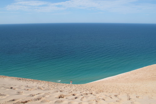 "View of Lake Michigan from the dune outlook at Sleeping Bear Dunes National Lakeshore in Michigan. Photo by Barbara Newhall. Barbara Falconer Newhall travels up and down Michigan's lower peninsula, visiting friends and family and putting on book events for ""Wrestling with God."""