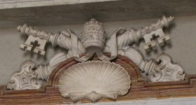 The papal keys in bas relief over the tomb of John Paul II, Vatican. Photo by Barbara Newhall