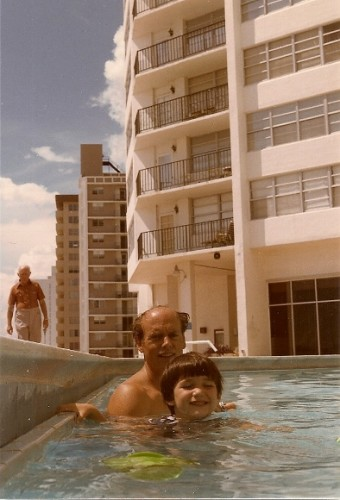 Father and 4-year-old son in a condominium swimming pool not designed for children in Miami Beach in 1985 with Atlantic in the background. Photo by Barbara Newhall