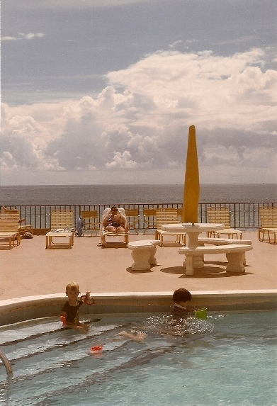 Two children play on the steps of a condominium pool in Miami Beach in 1985 with Atlantic in the background. Photo by Barbara Newhall
