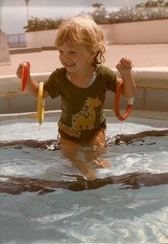 Toddler girl Christina in the adult pool at Miami Beach condominium, not designed for children. Photo by Barbara Newhall