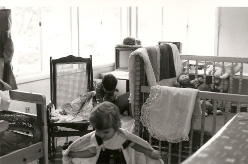 A 1986 home office with computer, crib, toddler and cat. Photo by Barbara Newhall