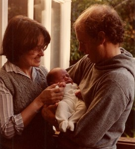 A newborn baby, a few weeks old, is held by his adoring parents. Barbara Newhall Photo
