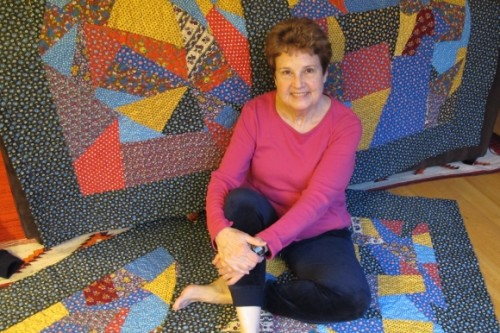 Author Barbara Falconer Newhall with the four calico crazy quilts she designed for the four grandchildren she hopes she'll have. Photo by Jon Newhall