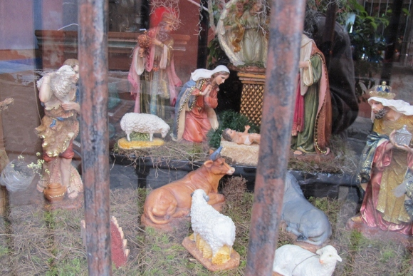 Nativity scene in a San Miguel de Allende, Mexico, shop window with Baby Jesus, Mary and other figurines. Photo by Barbara Newhall