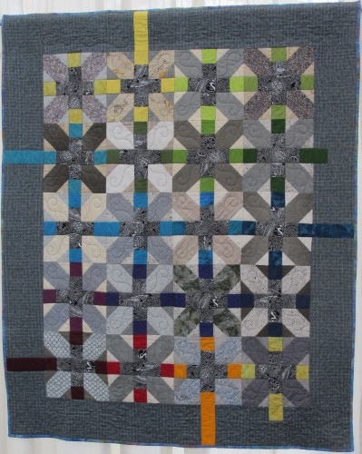 "At the East Bay Heritage Quilters show,""Voices in Cloth 2016,"" in Richmond, CA, HEATHER JACOBSEN presented her angular quilt in shades of blue and gray, ""Bo's Quilt 1.0,"" which her son outgrew as she made it. Photo by Barbara Newhall"
