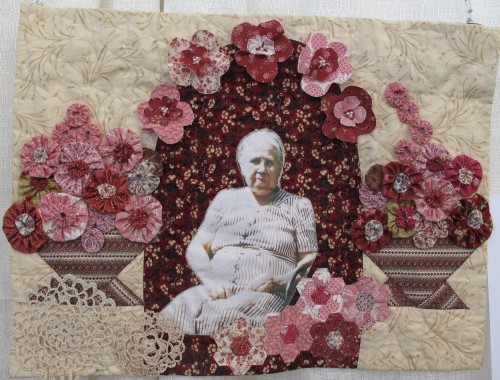 "On display at the East Bay Heritage Quilters show ""Voices in Cloth 2016"" in Richmond, CA, a quilt showing a photograph of ""Hannah Deverger Sandell"" was made in honor of quilter Suzi Stone's grandmother. Photo by Barbara Newhall"