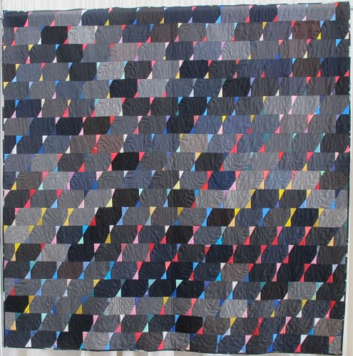 "On display at the East Bay Heritgage Quilters show ""Voices in Cloth 2016"" in Richmond, CA. , a grey-blue quilt made of suiting material, ""Suits,"" by Arleen Kukua. Photo by Barbara Newhall"