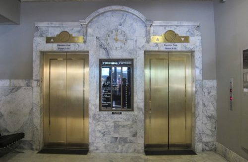 Brass and marble elevator bank at the Oakland Tribune Tower. On April 4, 2016, former employees of the Oakland, California, Tribune, had a wake in honor of the paper's last day of publication. Photos by Barbara Newhall