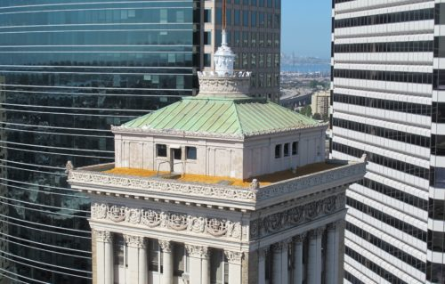 the view from the Oakland Tribune Tower. In the foreground, the Bank of America Building. In the background, the 1111 Broadway and the Clorox Building. In the distance, the Bay Bridge. Photos by Barbara Newhall