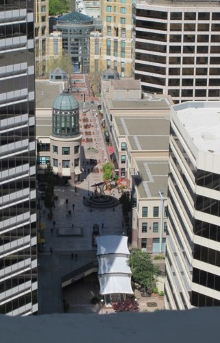 April 4, 2016. Photo by Barbara Newhall. Looking NW from the Oakland, CA, Tribune Tower into Oakland City Center Walk. Clorox company building at left, Citibank to the right.