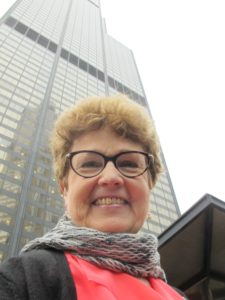 Author Barbara Falconer Newhall before the Willis Tower, Chicago. Photo by Jon Newhall