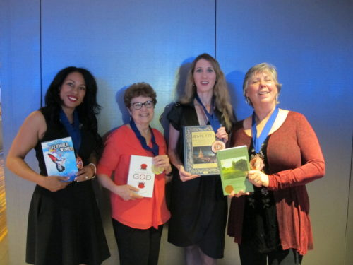 "Veda Stamps (""Flexible Wings,"" IMO Books), barbara Newhall (""Wrestling with God""), Laura A. Ackley (""San Francisco's Jewel City,"" Heyday), Aleta George (""Ina CoolBrith,"" Shifting Plates Press) at IPPY awards 2016. Photo by Jon Newhall"
