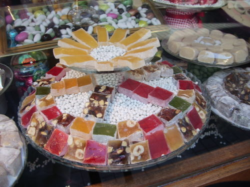 Squares of Turkish delight candy colorfully arranged in a shop window along the pedestrian shopping street İstiklal Caddesi in Istanbul. Photo by Barbara Newhall