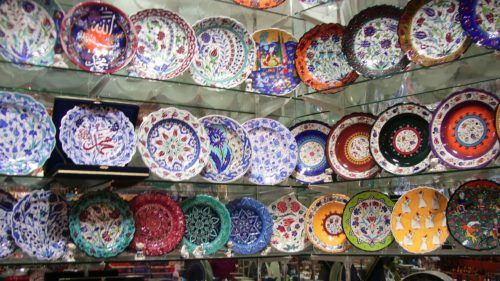 The walls of a shop along the pedestrian shopping street İstiklal Caddesi in Istanbul are lined with handpainted ceramic plates from Turkey. Photo by Barbara Newhall