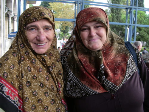 Two older, German-speaking Turkish women wearing colorful headscarves in Istanbul. Photo by Barbara Newhall