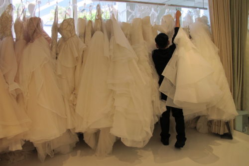 A rack of gowns poofy enough to fill a queen-sized comforter on sale at Le Marriage bridal salon in Los Angeles. Wedding dress shopping. Photo by Barbara Newhall