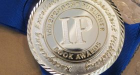 Book contests. An IPPY gold medal awarded to Wrestling with God, by Barbara Falconer Newhall, 2016. Photo by Barbara Newhall