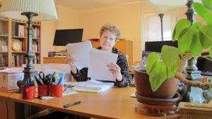 "Barbara Falconer Newhall at her home office desk getting ready to do final edits on her book, ""Wrestling with God."" Photo by Barbara Newhall"