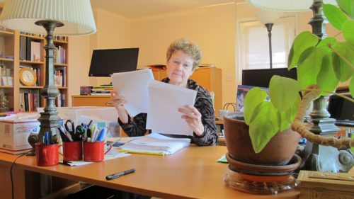"Kudos for Wrestling with God! Barbara Falconer Newhall at her home office desk getting ready to do final edits on her book, ""Wrestling with God."" Photo by Barbara Newhall"