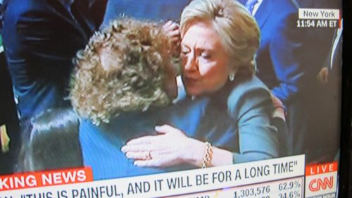 In a TV shot, Hillary Clinton hugs a supporter following her gracious concession speech, 2016. I'm inspired by Hillary. I'm going to stop bad-mouthing Donald Trump. Photo by Barbara Newhall