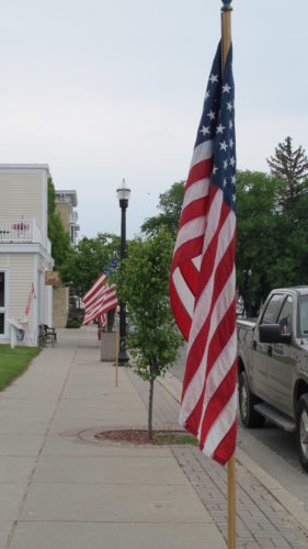Patriotic holiday gifts. The American flag flies in Pentwater, Michigan, which was a red state this year. Photo by Barbara Newhall
