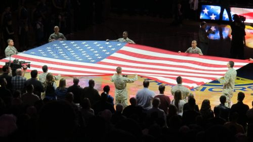 Patriotic holiday gifts: The American flag is spread at a Warriors basketball game in Oakland, CA. Photo by Barbara Newhall